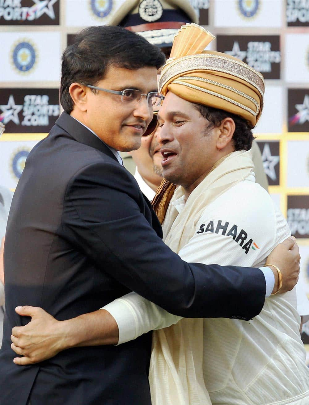 Master blaster Sachin Tendulkar is greeted by former captain Sourav Ganguly at the presentation ceremony after the end of the first Test match against West Indies at Eden Garden in Kolkata.