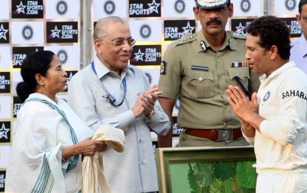 West Bengal Chief Minister Mamata Banerjee honours master blaster Sachin Tendulkar at the presentation ceremony after the end of the first Test match against West Indies at Eden Garden in Kolkata.