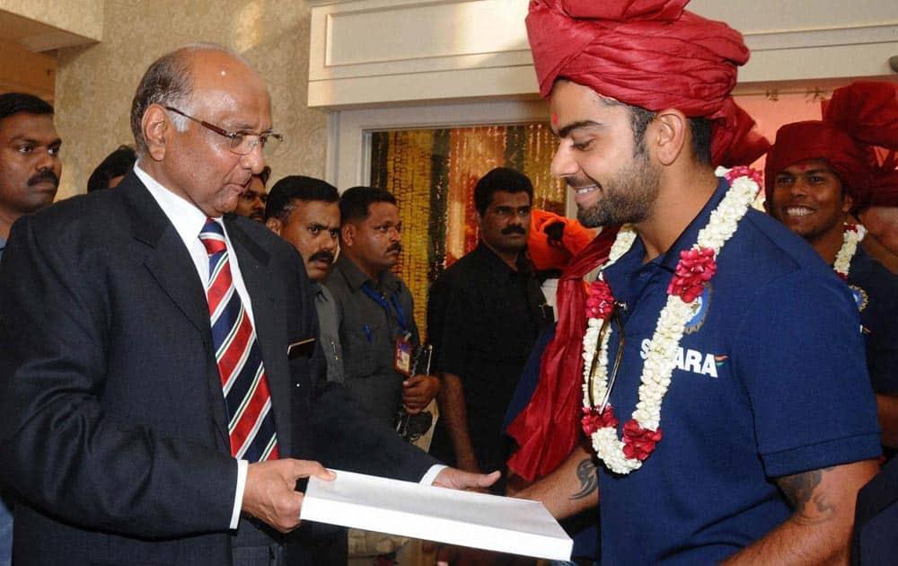 MCA, President Sharad Pawar(L) Virat Kohli during the Mumbai Cricket Association's Sachin Tendulkar Gymkhana naming function at Kandivali, North Mumbai.