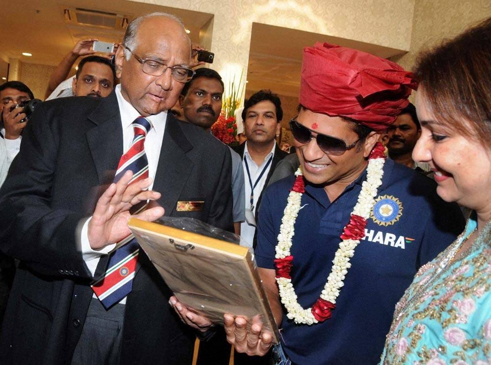 MCA, President Sharad Pawar (L) with Sachin Tendulkar and his wife Anjali (R) during the Mumbai Cricket Association's Sachin Tendulkar Gymkhana naming function at Kandivali, North Mumbai.