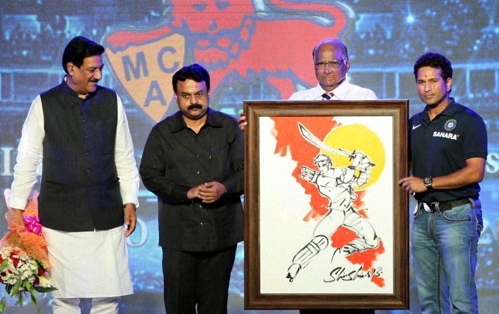 Maharashtra CM Prithviraj Chavan, Mayor Sunil Prabhu and agriculture Minister Sharad Pawar felicitating Master Blaster Sachin Tendulkar during the inauguration of Sachin Tendulkar Gymkhana Club in North Mumbai.