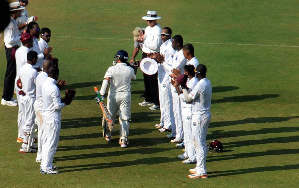 Sachin Tendulkar walks to bat amid a guard of honour on Day 1 of the 2nd test match against West Indies at Wankhede Stadium in Mumbai.