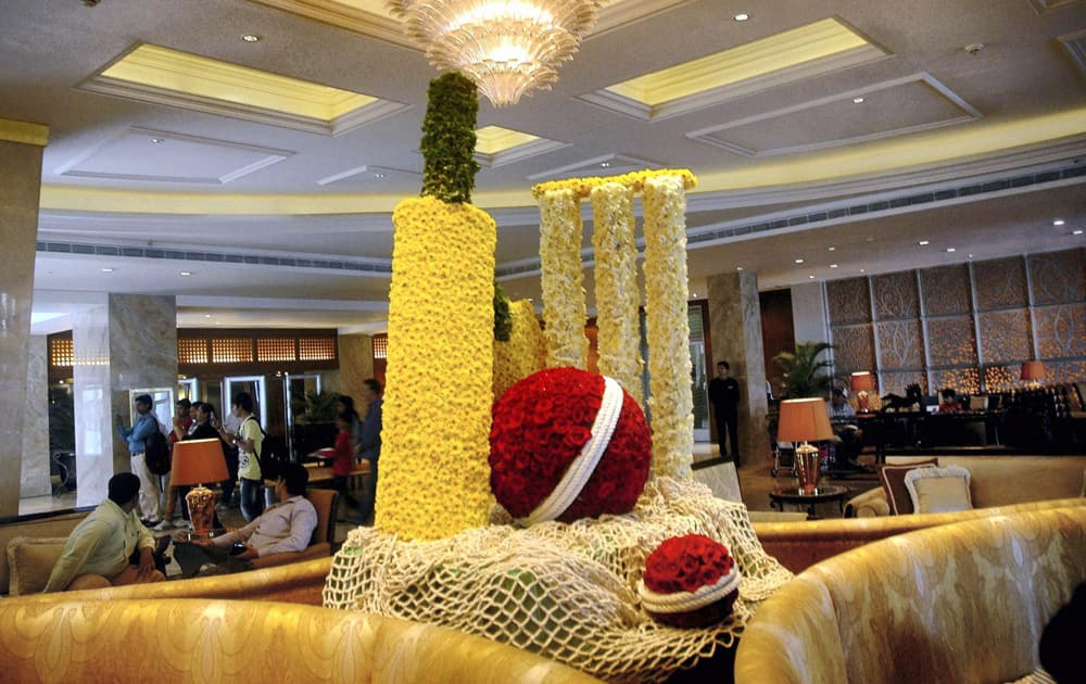 A view of Hotel Taj Mahal Palace lobby where a cricket bat, ball and stumps, made of flowers, are arranged in the honour of cricketer Sachin Tendulkar's last test, in Mumbai.