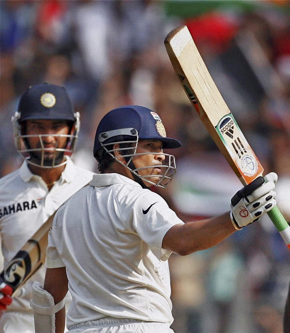 Master blaster Sachin Tendulkar raises his bat to acknowledge the crowd after his half century against West Indies on Day 2 of the final Test match at Wankhede Stadium in Mumbai.