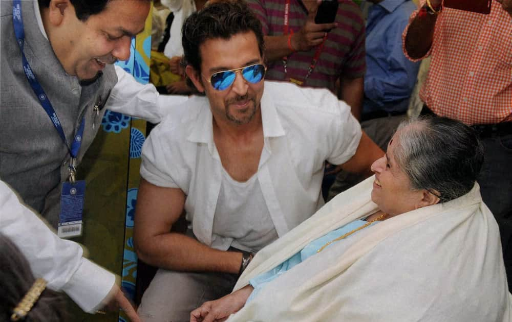 BCCI Vice President Rajeev Shukla, Bollywood actor Hritik Roshan with Sachin Tendulkar's mother at Wankhede Stadium on Day 2 of the final Test match between India and West Indies in Mumbai.