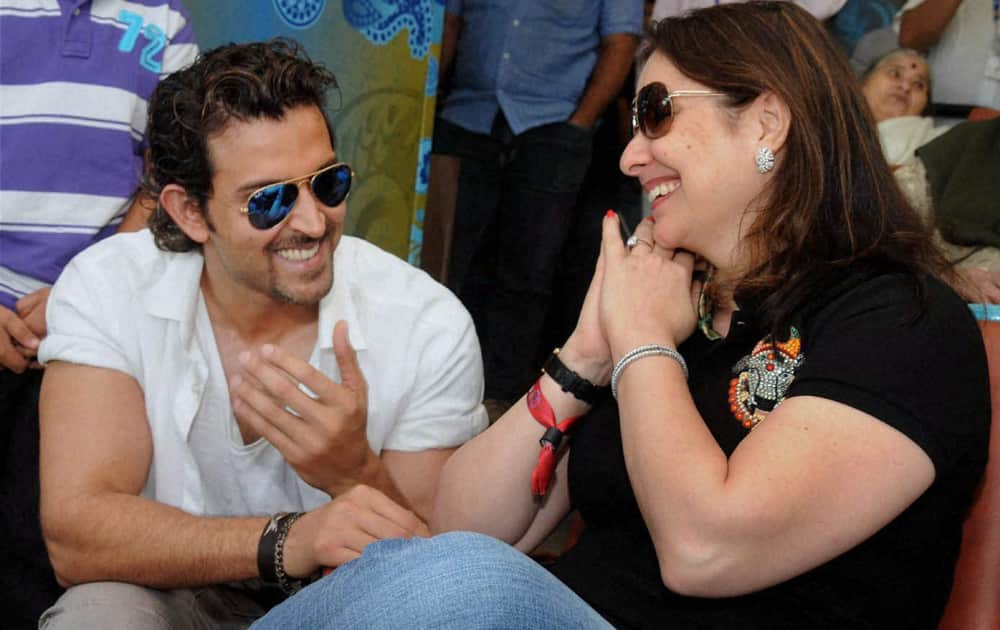 Hritik Roshan with Sachin Tendulkar's wife Anjali at Wankhede Stadium on Day 2 of the final Test match between India and West Indies in Mumbai.
