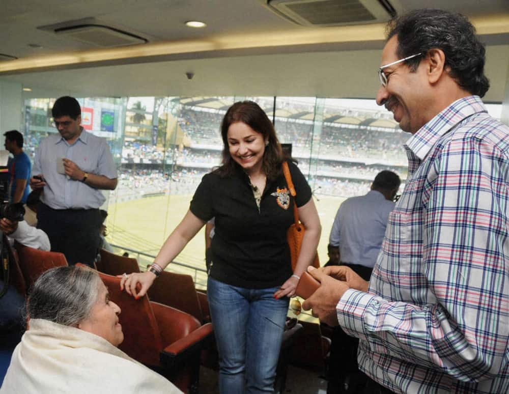 Shiv Sena Executive President Uddhav Thackeray (R) with Sachin Tendulkar's mother Rajni Tendulkar and wife Anjali at Wankhede Stadium on Day 2 of the final Test match between India and West Indies in Mumbai.