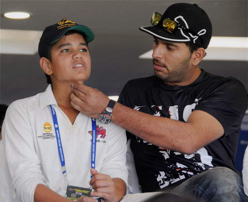 Yuvraj Singh and Sachin Tendulkar's son Arjun at Wankhede Stadium on Day 2 of the final Test match between India and West Indies in Mumbai.