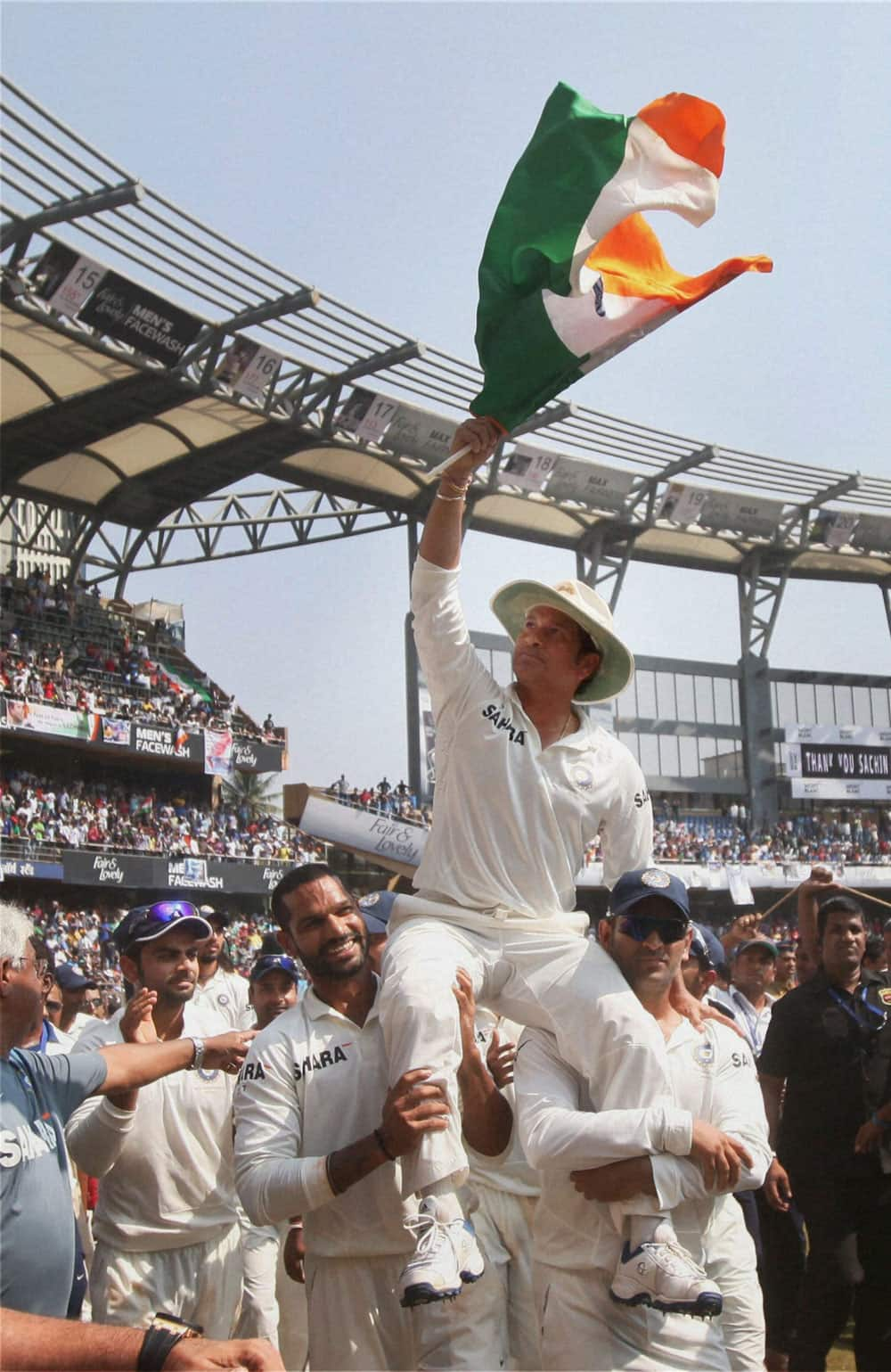 Sachin Tendulkar is given a farewell lap by his team mates as they carry him on his shoulders after he bid a tearful adieu to International Cricket at Wankhede Stadium in Mumbai.