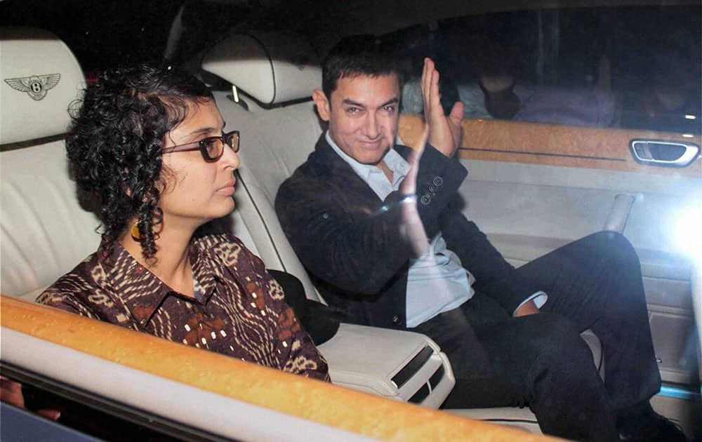 Bollywood actor Aamir Khan with wife Kiran on the way to attend a farewell party hosted by Sachin and Anjali Tendulkar in Mumbai.