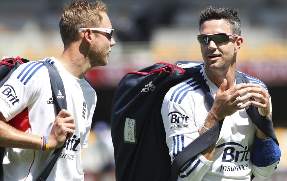 Stuart Broad talks to fellow team member Kevin Pietersen during the final training session on the eve of the first test in the Ashes Series between England and Australia, in Brisbane, Australia.