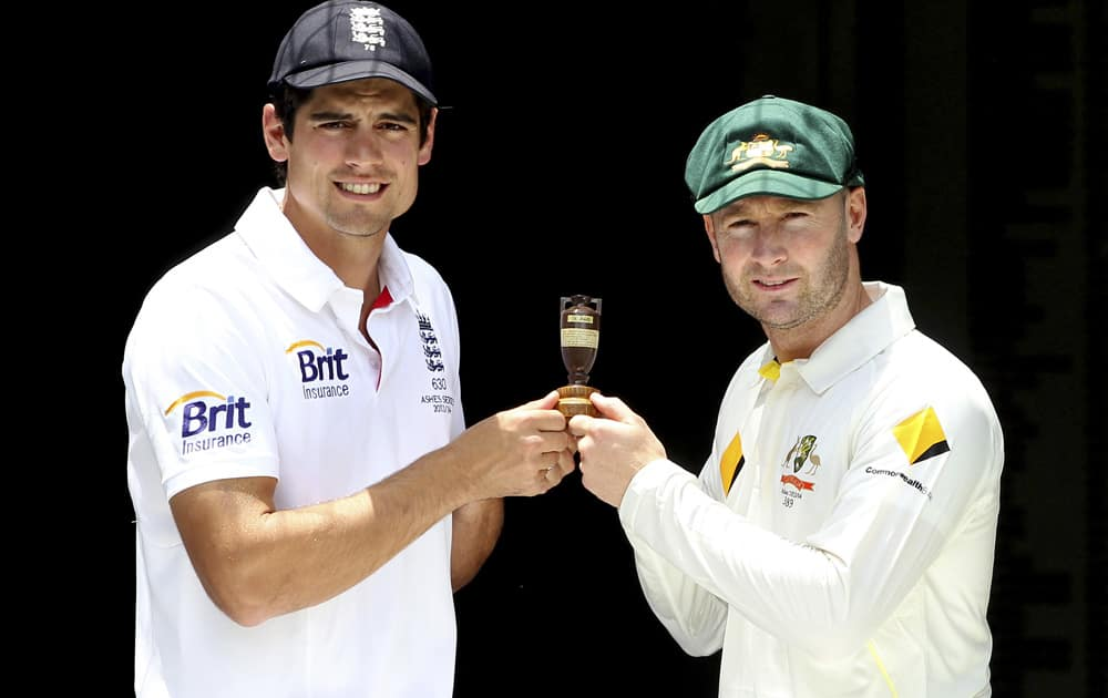 England captain Alastair Cook and Australian captain Michael Clarke pose with the replica of Ashes urn on the eve of the first test in the Ashes Series between England and Australia, in Brisbane, Australia.