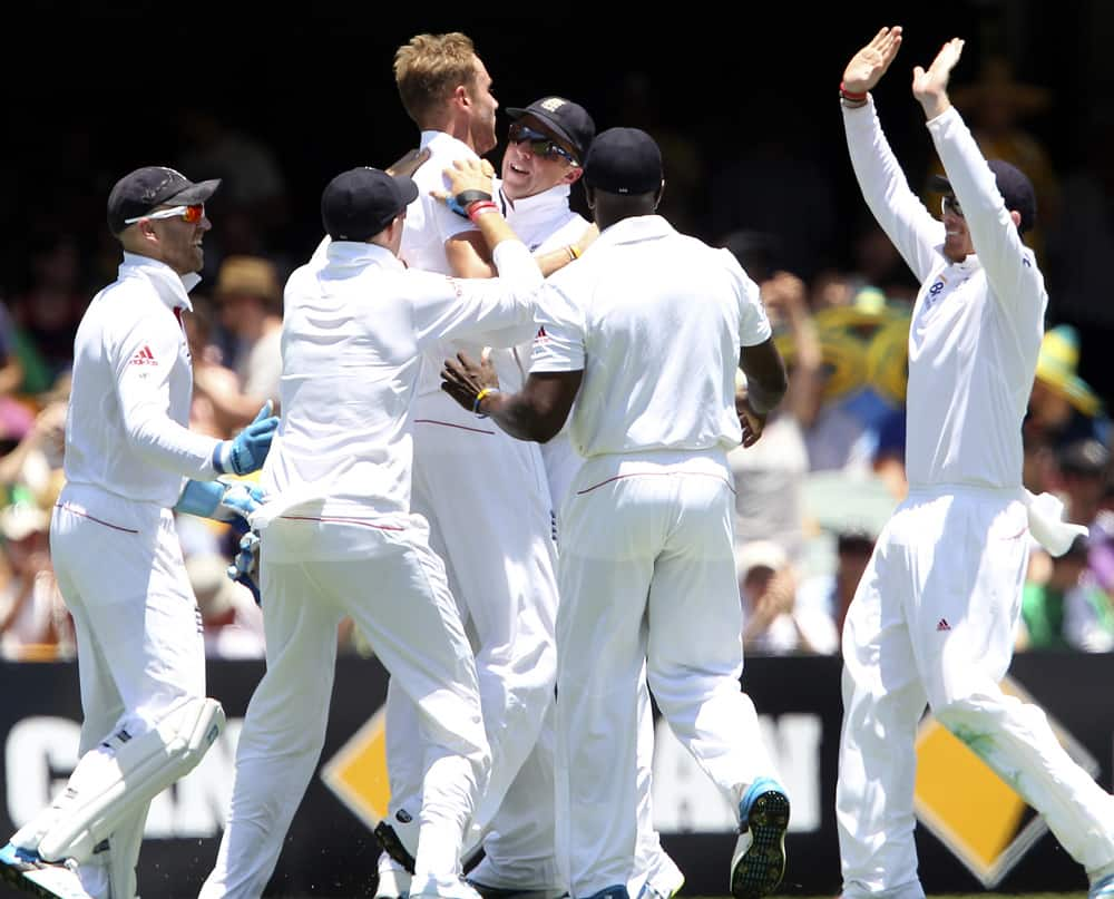 Stuart Broad celebrates with his teammates after he got the wicket of Australia's Shane Watson on the first day of the series-opening Ashes test between England and Australia at the Gabba in Brisbane, Australia.