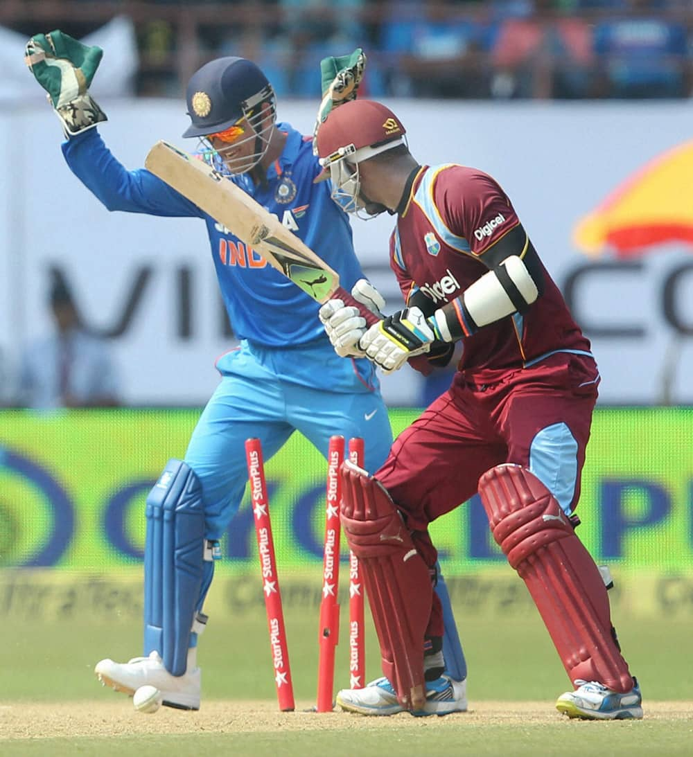 Marlon Samuels of West Indies is bowled during the 1st ODI cricket match against India in Kochi.