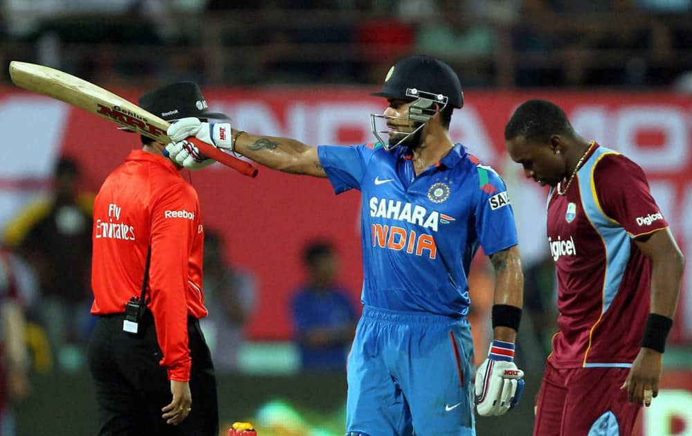Virat Kohli celebrate his fifty runs against West Indies during the 1st ODI in Kochi.