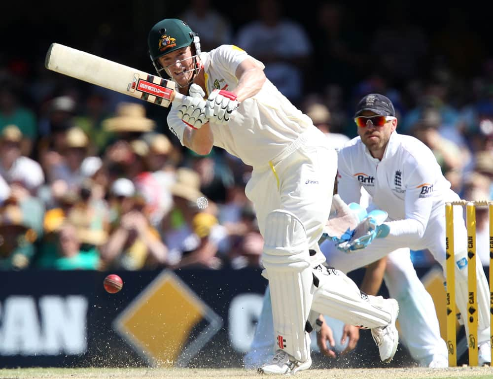 Australia's George Bailey plays a shot in front of England wicketkeeper Matt Prior, right, on the third day of their series-opening Ashes cricket test at the Gabba in Brisbane, Australia.