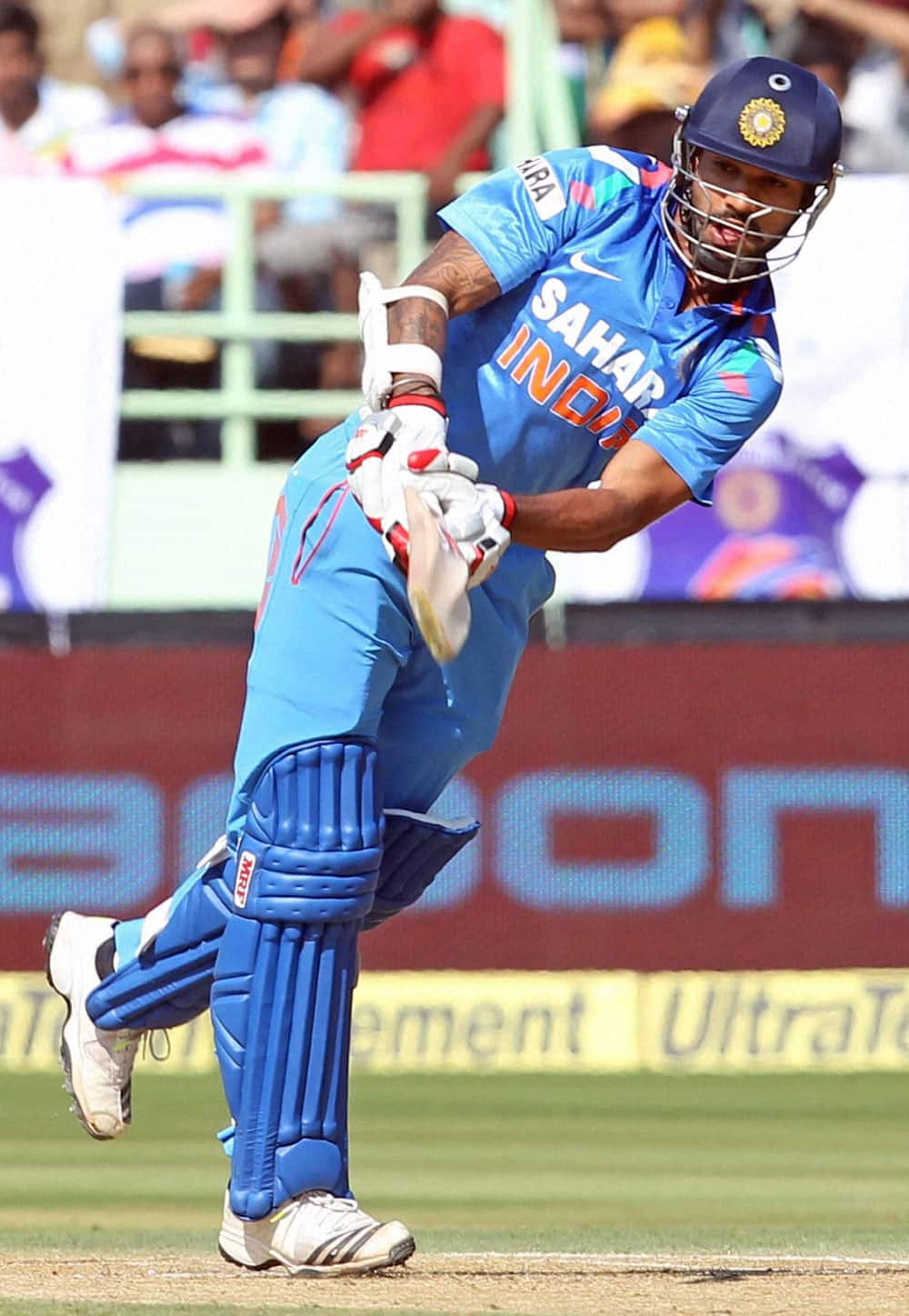 Indian Cricketer S Dhawan plays a shot during India vs West Indies 2nd ODI Match in Visakhapatnam.