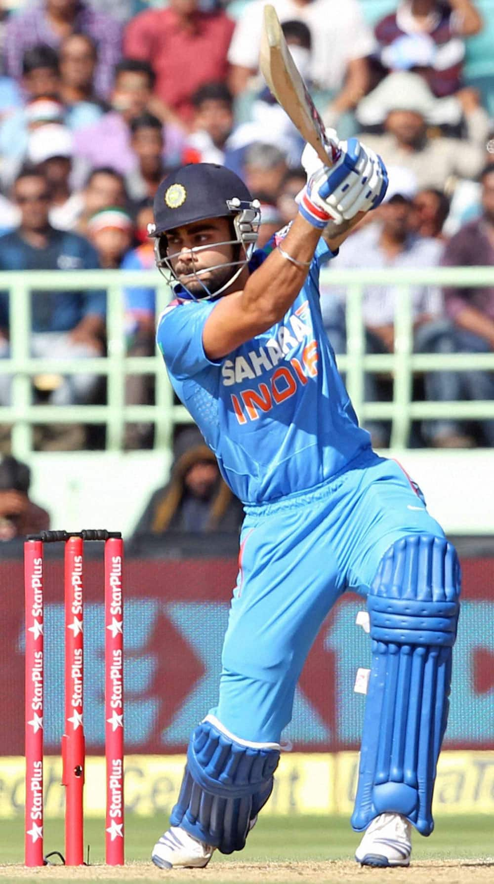 Cricketer Virat Kohli plays a shot during India vs West Indies 2nd ODI match in Visakhapatnam.