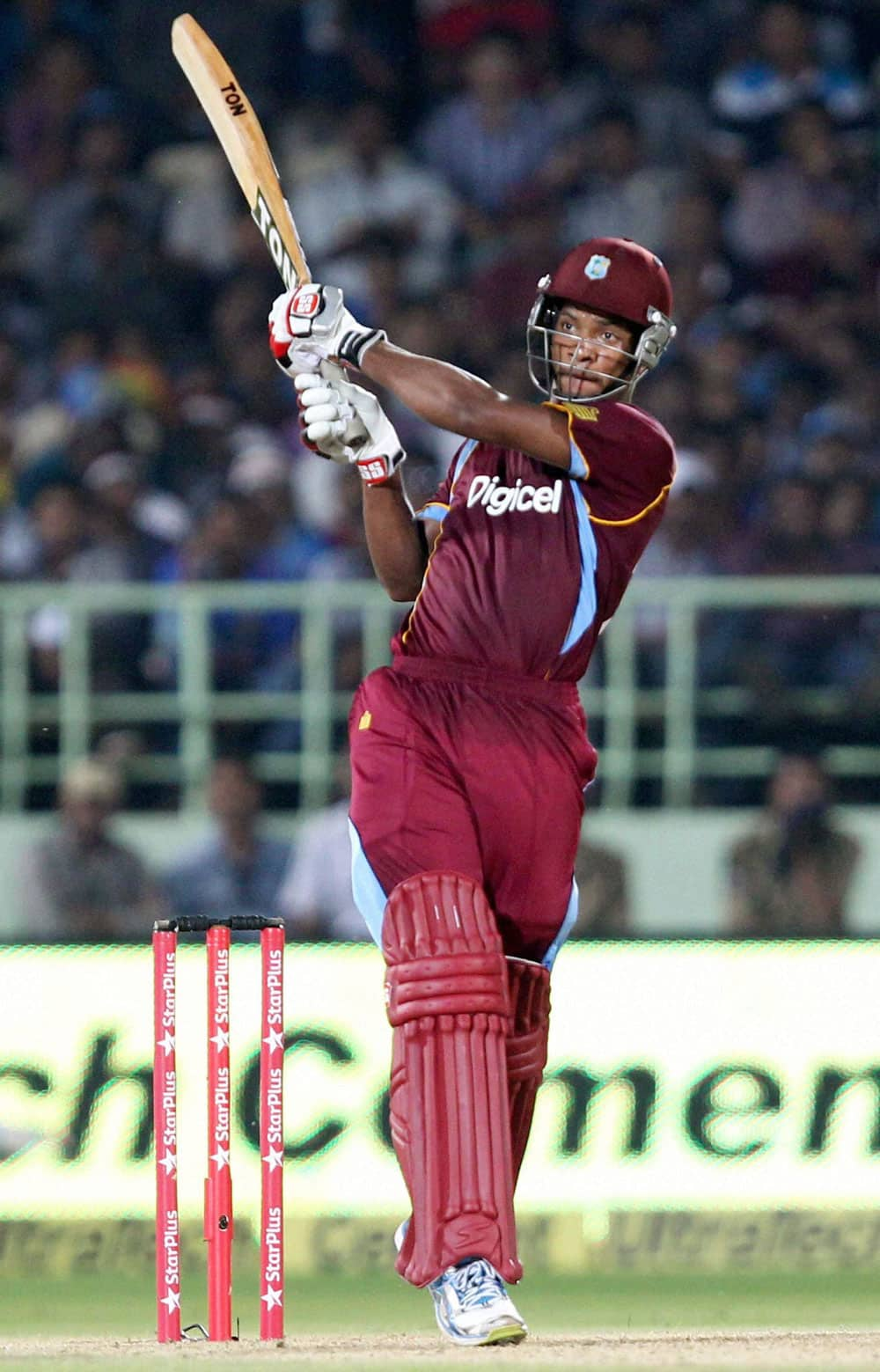 West Indies Cricketer K Powell plays a shot during India vs West Indies 2nd ODI Match in Visakhapatnam.