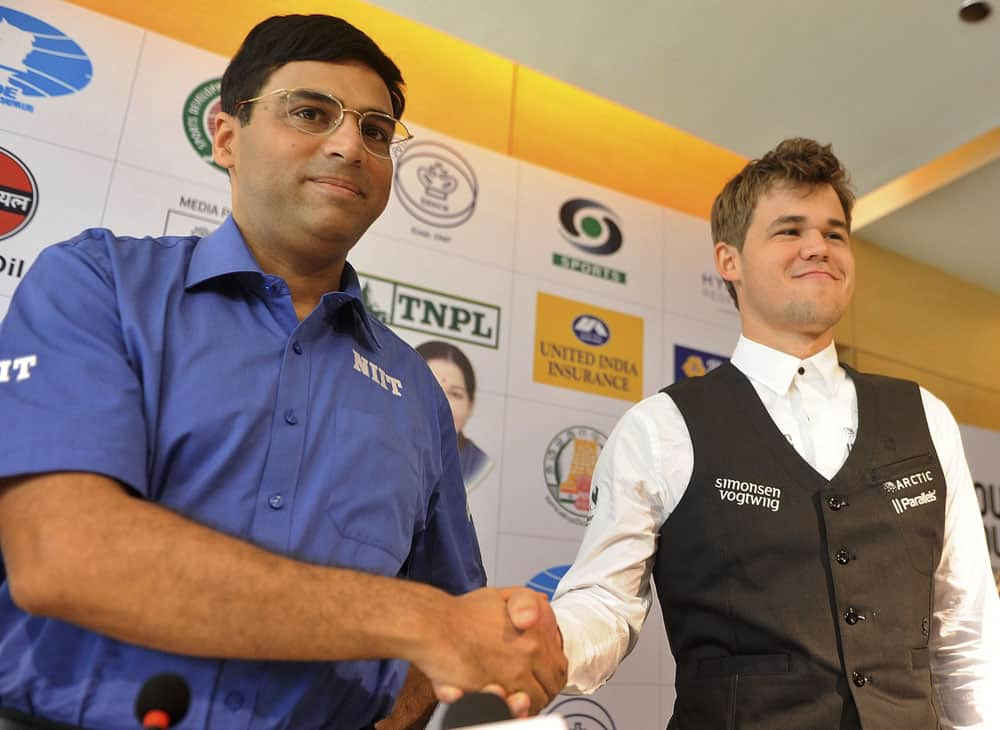 Reigning world chess champion India's Viswanathan Anand, left and world's top-ranked player Norway's Magnus Carlsen pose for the media at a press conference ahead of the FIDE World Chess Championship in Chennai.