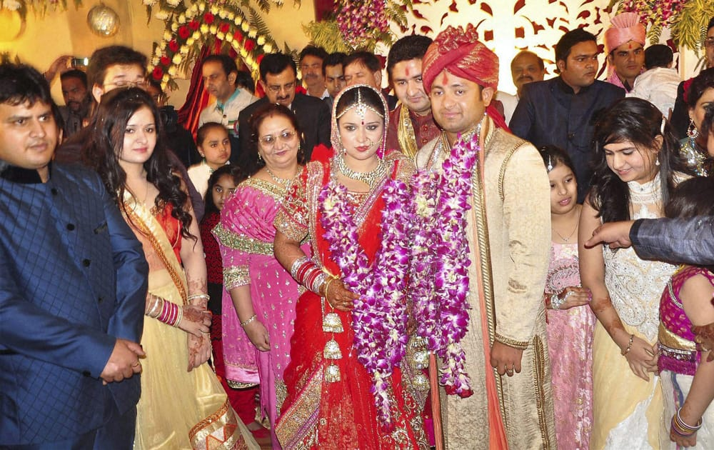 Piyush Chawla and Anubhuti Chauhan posing for photographers during their wedding ceremony in Moradabad.