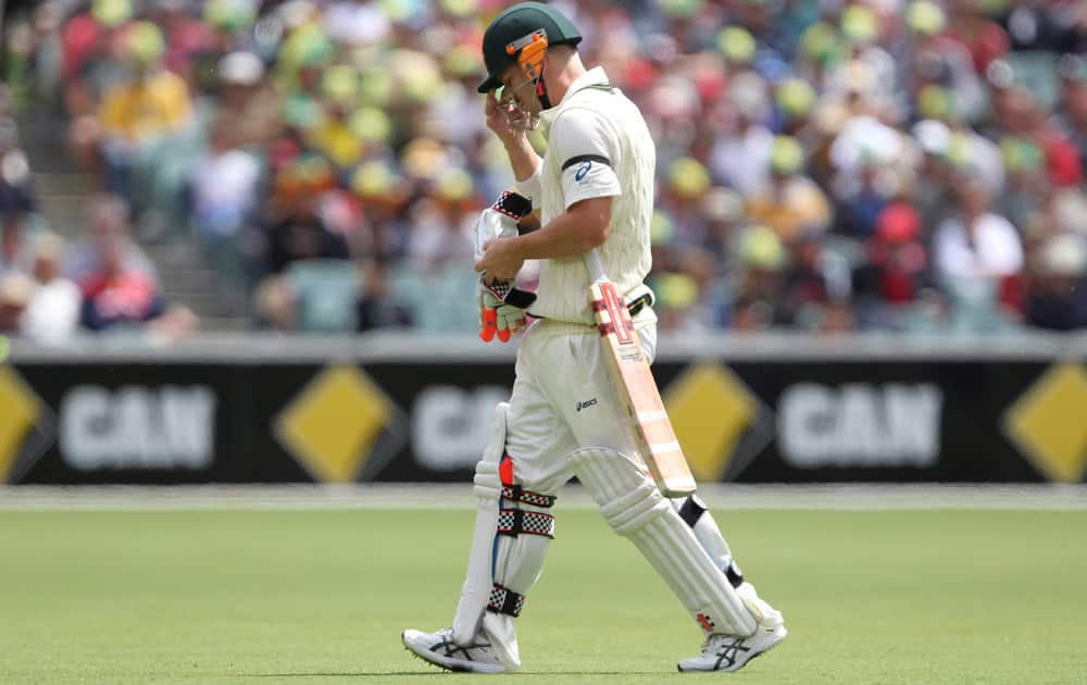Australia's David Warner walks after losing his wicket during the second Ashes cricket test match between England and Australia, in Adelaide, Australia.