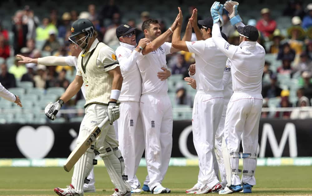 England players celebrate the wicket of Australia's Shane Watson during their second Ashes cricket test match in Adelaide, Australia.