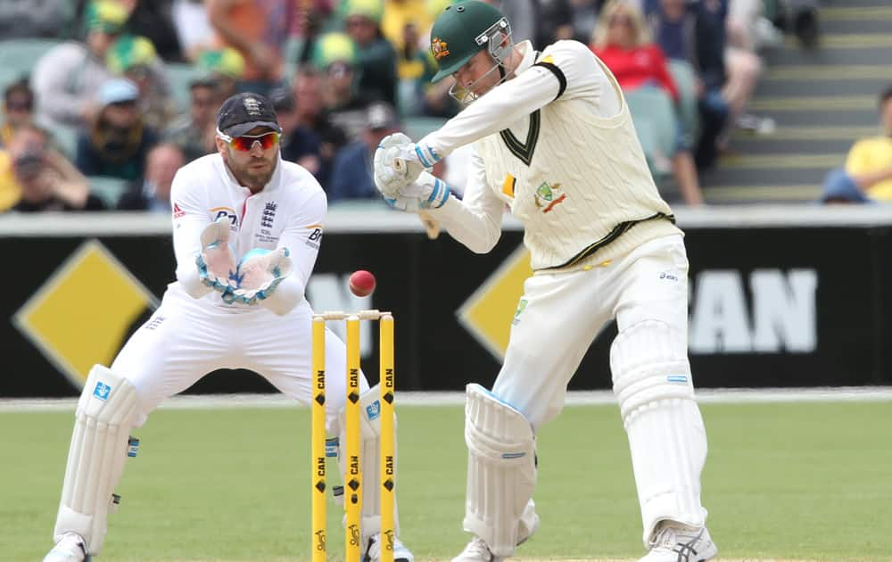 Michael Clarke cuts the ball in front of England's Matt Prior during the second Ashes cricket test match between England and Australia, in Adelaide, Australia.