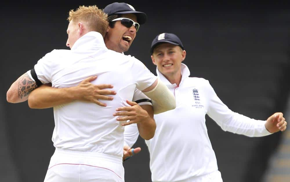 England's Ben Stokes, left, Alistair Cook, center, and Joe Root celebrate the wicket of Brad Haddin but was ruled a no ball and not out during the second Ashes cricket test match between England and Australia, in Adelaide.
