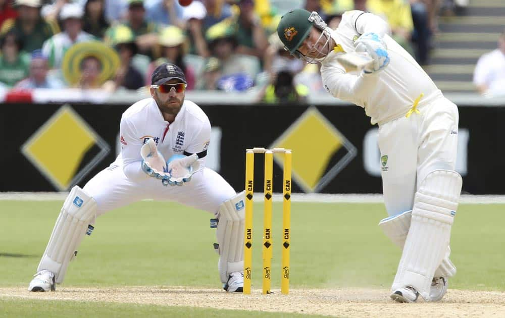 Australia's Michael Clarke drives the ball in front of England's Matt Prior during the second Ashes cricket test match between England and Australia, Adelaide, in Australia.