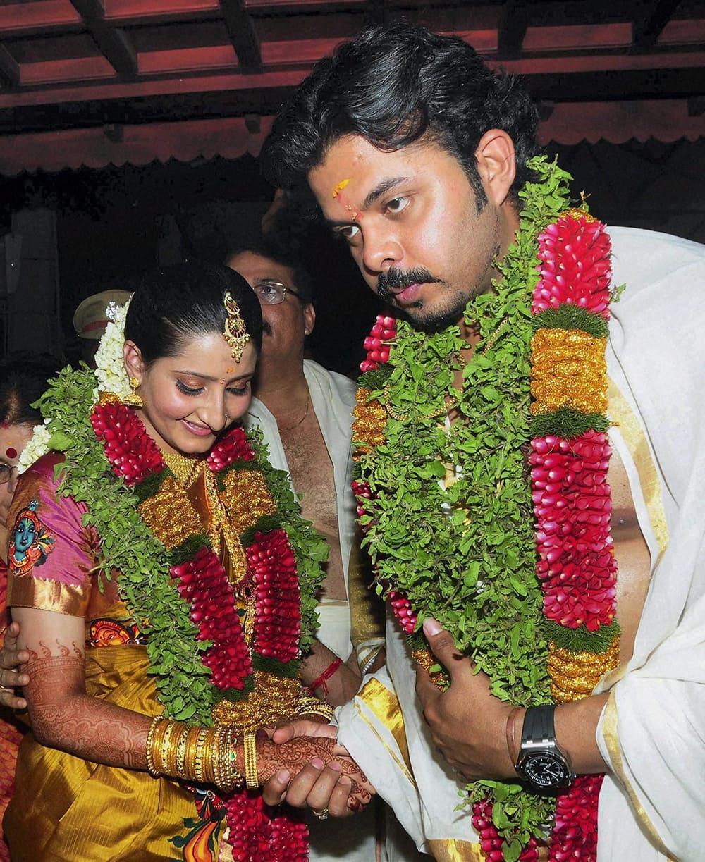 Cricketer S Sreesanth with Bhuwneswari Kumari, hailing from a royal family in Rajasthan, during their wedding at Sri Krishna temple in Guruvayur.