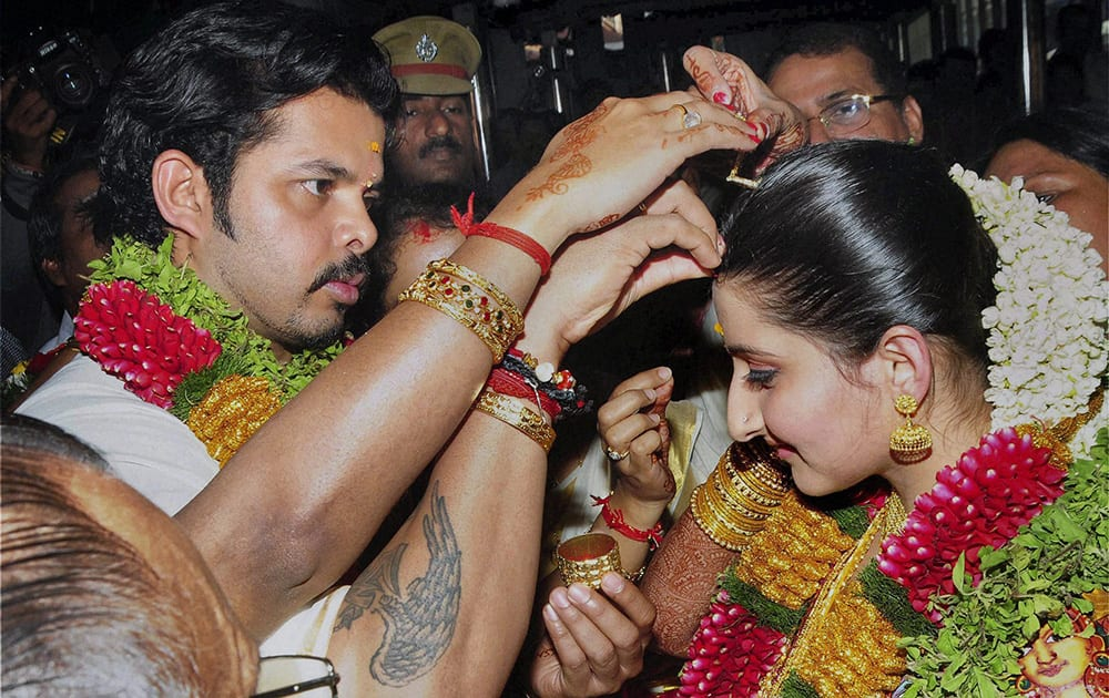 Cricketer S Sreesanth exchanging wedding vows with Bhuwneswari Kumari, hailing from a royal family in Rajasthan, at Sri Krishna temple in Guruvayur.