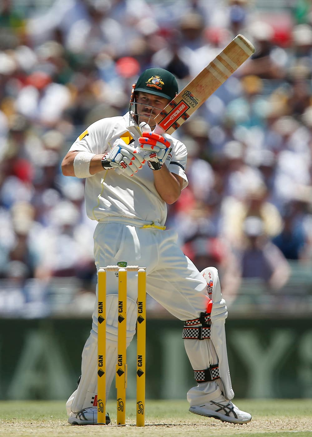 Australia's Dave Warner plays a hook shoot on the first day of the Ashes cricket test match against England in Perth, Australia.