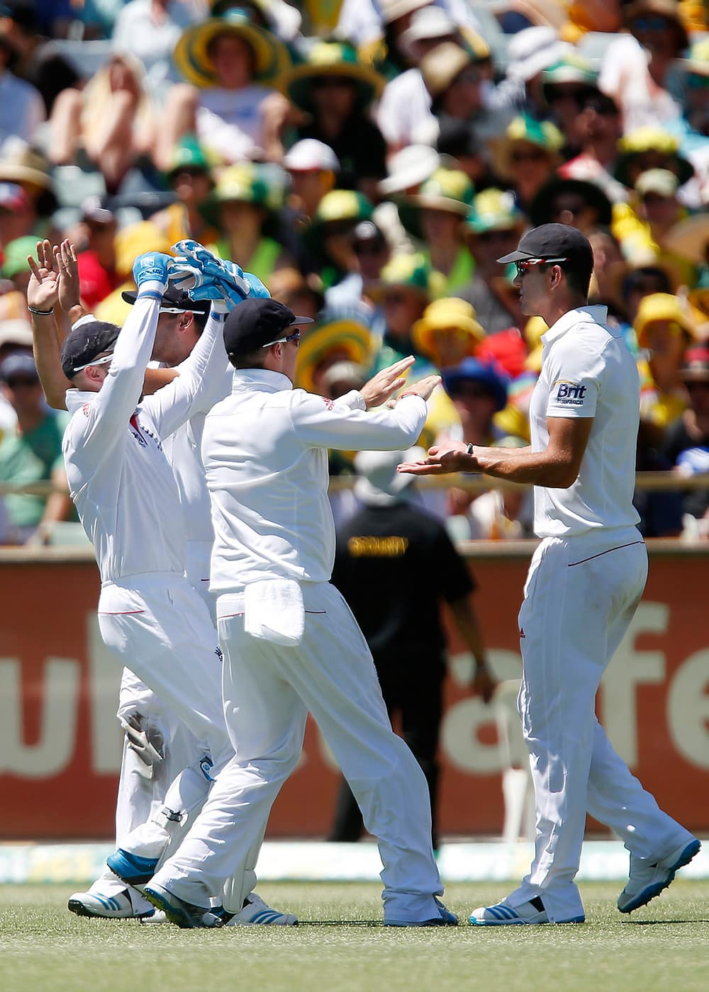 England's Kevin Pietersen is congratulated by team mates after taking the catch of Australia's George Bailey on the first day of the Ashes cricket test match in Perth, Australia.