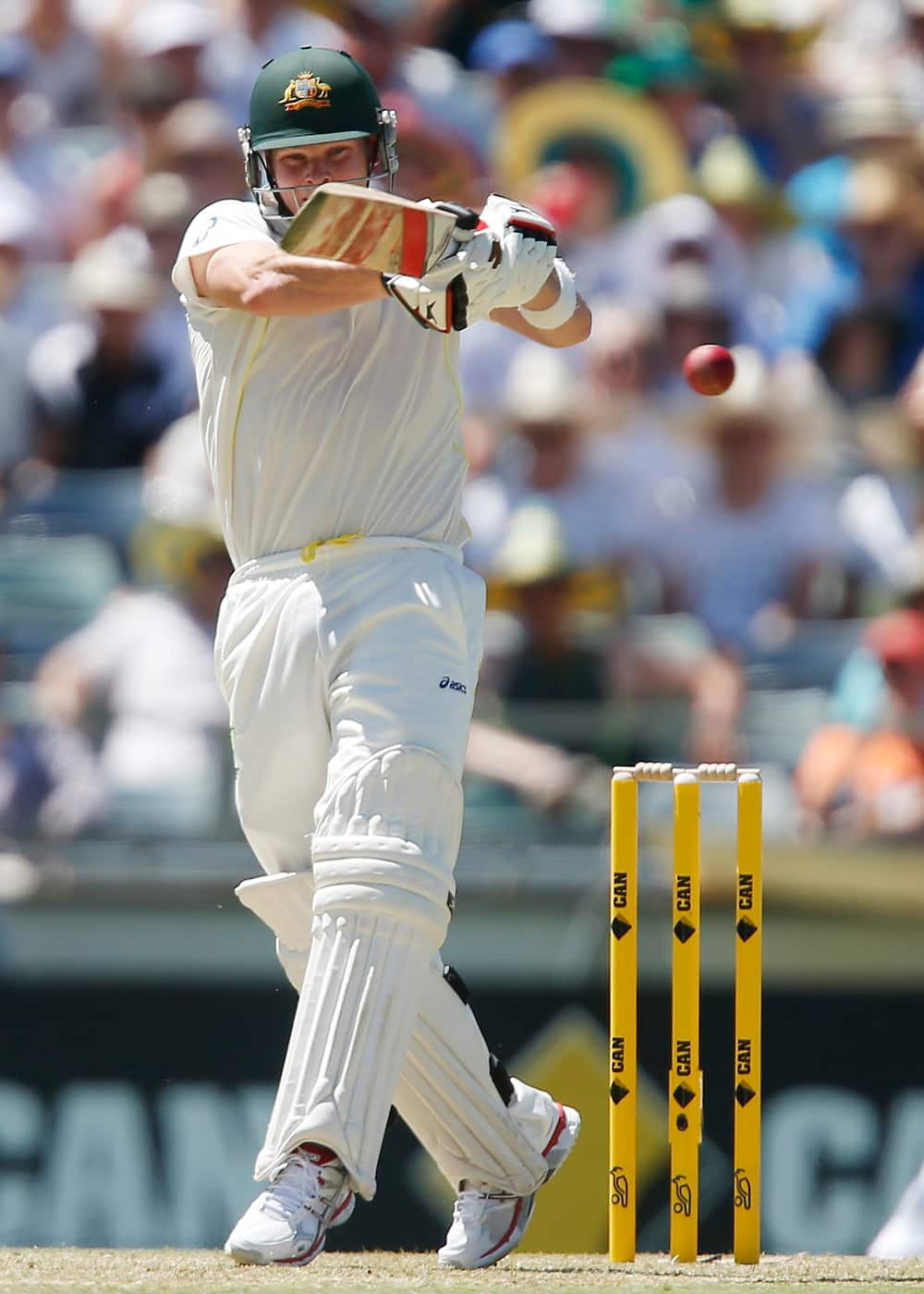 Australia's Steve Smith plays a hook shot against England on the first day of their Ashes cricket test match in Perth, Australia.