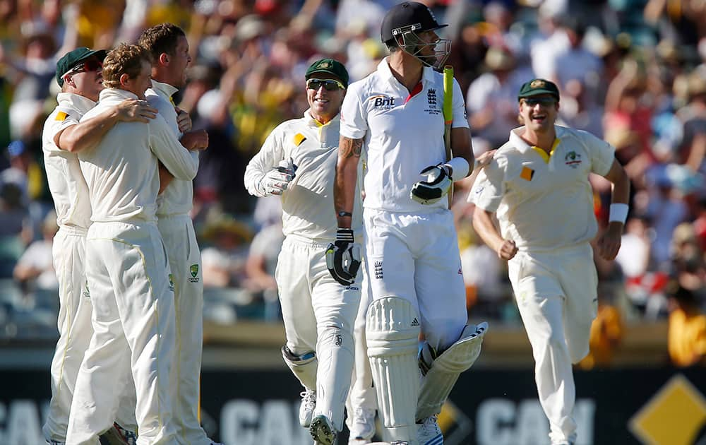 England's Kevin Pietersen walks back to the pavilion after being caught out for 19 runs on the second day of their Ashes cricket test match against Australia in Perth, Australia.