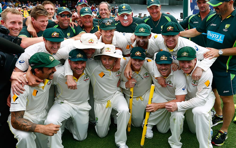 Australian team poses for group photo after winning their Ashes cricket test match over England in Perth, Australia.