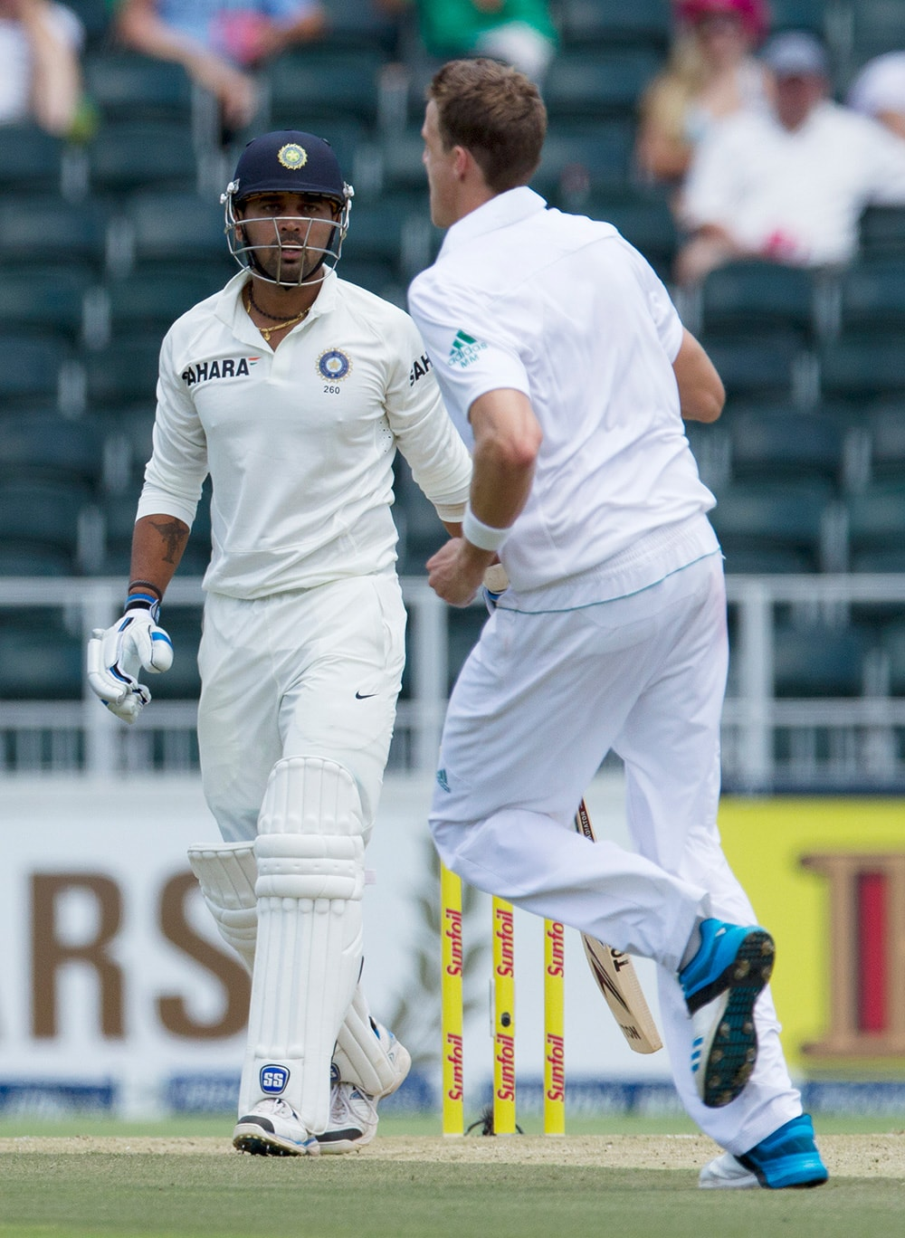 Murali Vijay watches as South Africa's bowler Morne Morkel celebrates his dismissal during the first day of their cricket test match at Wanderers stadium in Johannesburg, South Africa.