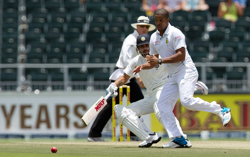 Vernon Philander attempt fielding off his own bowling as Virat Kohli runs back home during the first day of their cricket test match at Wanderers stadium in Johannesburg, South Africa.