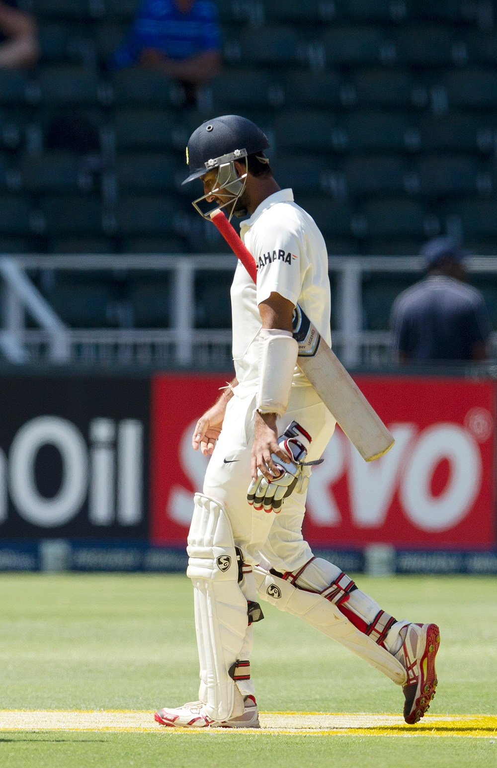 Cheteshwar Pujara, walks back to the pavilion after being dismissed for 25 runs during the first day of their cricket test match at Wanderers stadium in Johannesburg, South Africa.