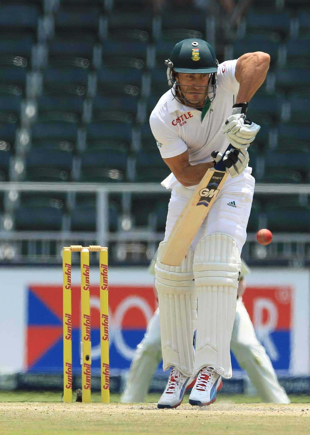 South Africa's batsman Francois du Plessis plays a side shot during the fourth and final day of their cricket test match against India at Wanderers stadium in Johannesburg, South Africa.