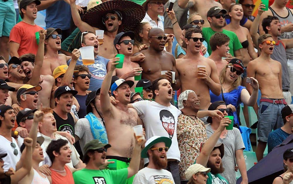 South African cricket fans sing during first day of their cricket test match between South Africa and India at Kingsmead stadium, Durban.
