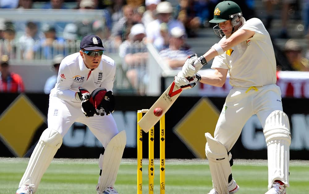 England's Jonny Bairstow is set as Australia's Steve Smith plays a shot during their Ashes cricket test match at the Melbourne Cricket Ground in Melbourne, Australia.