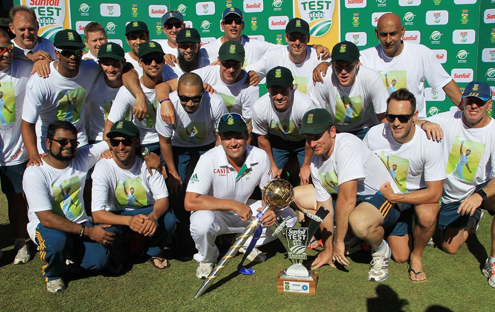 South Africa players and team members pose for photographers after winning the cricket test series against India at Kingsmead stadium, Durban, South Africa.