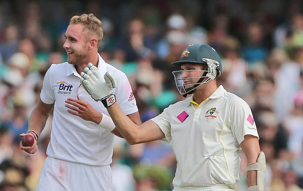 Australia's Ryan Harris and England's Stuart Broad chat during their Ashes cricket test match in Sydney.