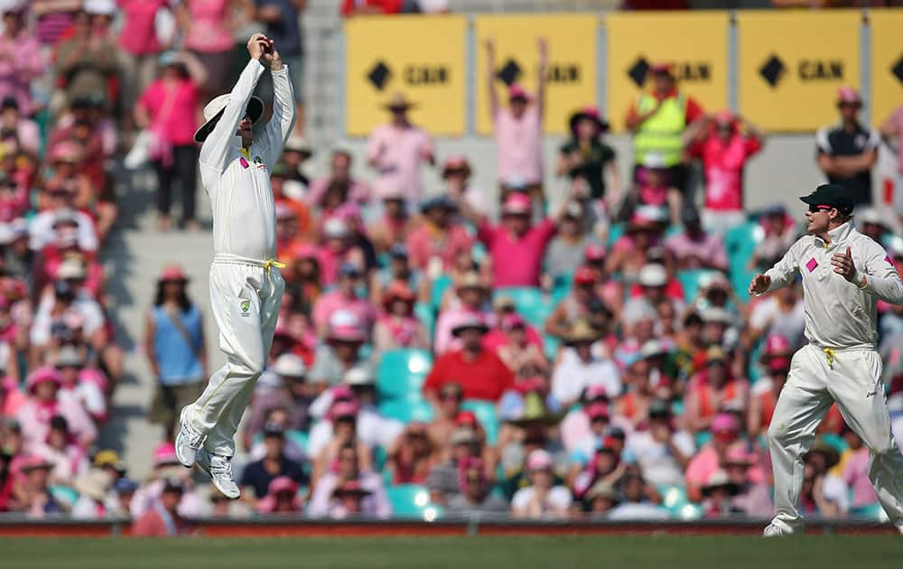Australian captain Michael Clarke makes the last catch for victory over England on day 3 of their Ashes cricket test match at the Sydney Cricket Ground in Sydney.