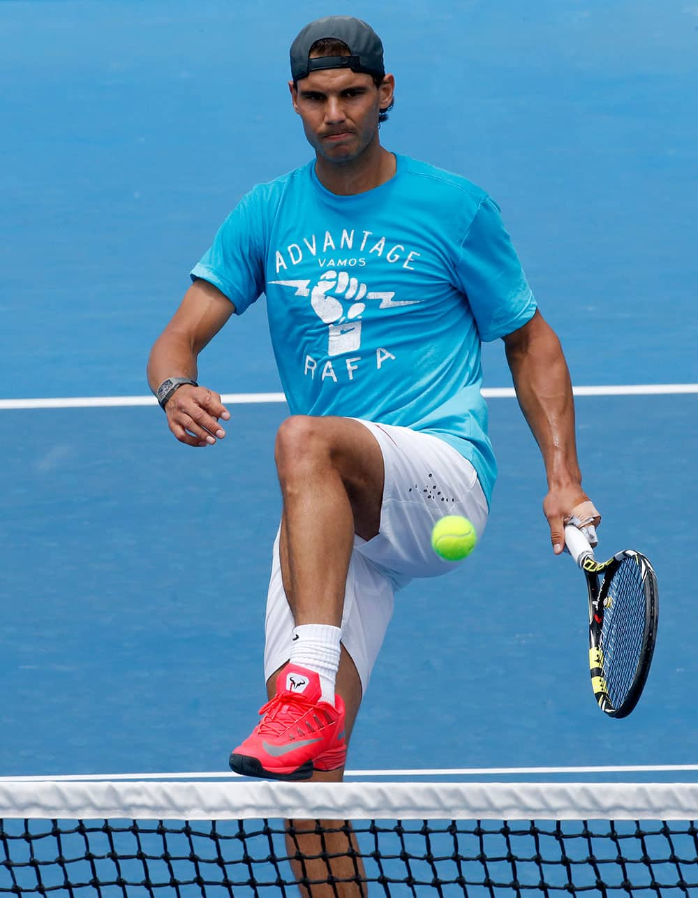 Rafael Nadal of Spain kicks the ball during a practice session ahead of the Australian Open tennis championship.