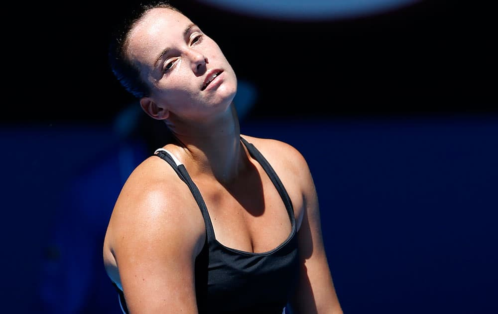 Jarmila Gajdosova of Australia reacts to a lost point against Angelique Kerber of Germany during their first round match at the Australian Open tennis championship in Melbourne.