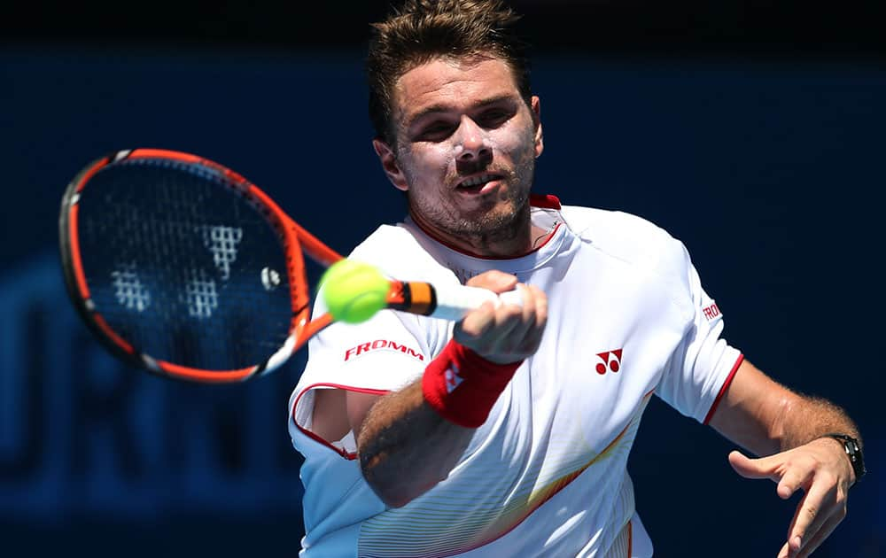 Stanislas Wawrinka of Switzerland makes a forehand return to Andrey Golubev during their first round match at the Australian Open tennis championship in Melbourne.