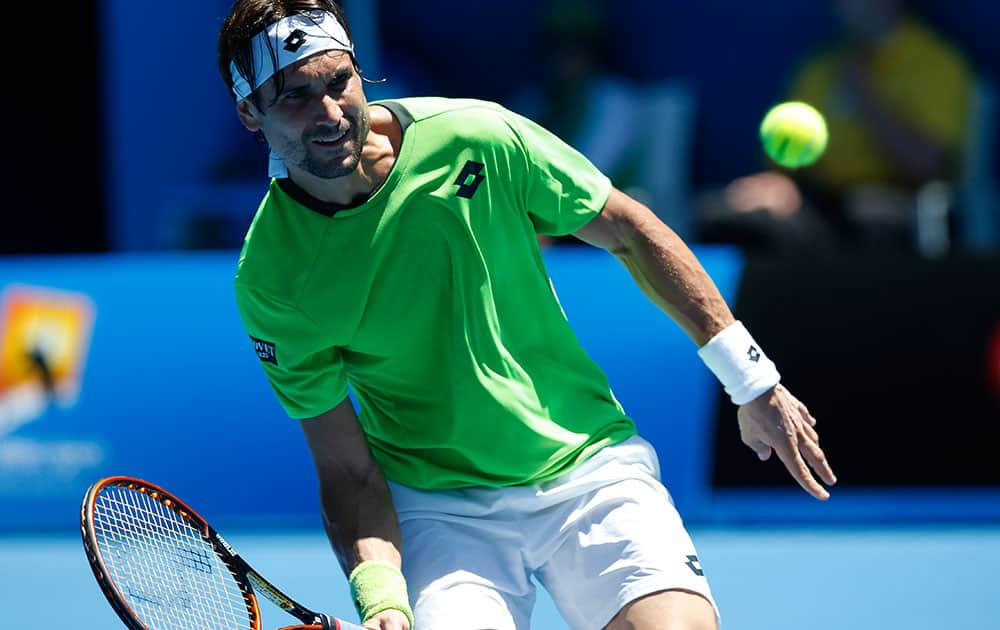 David Ferrer of Spain makes a forehand return to Alejandro Gonzalez of Colombia during their first round match at the Australian Open tennis championship in Melbourne.